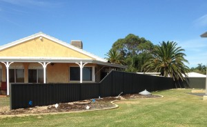 1. Black Colorbond side fencing.